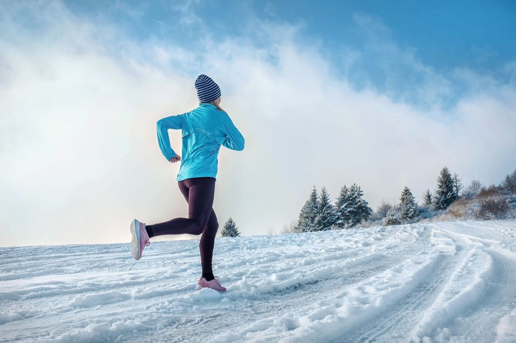 Person jogging in the snow