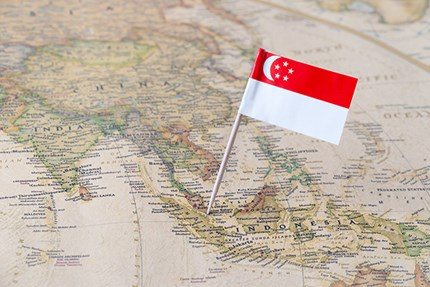 Asia map and Singapore's flag. Photo: Sjankauskas/ Dreamstine