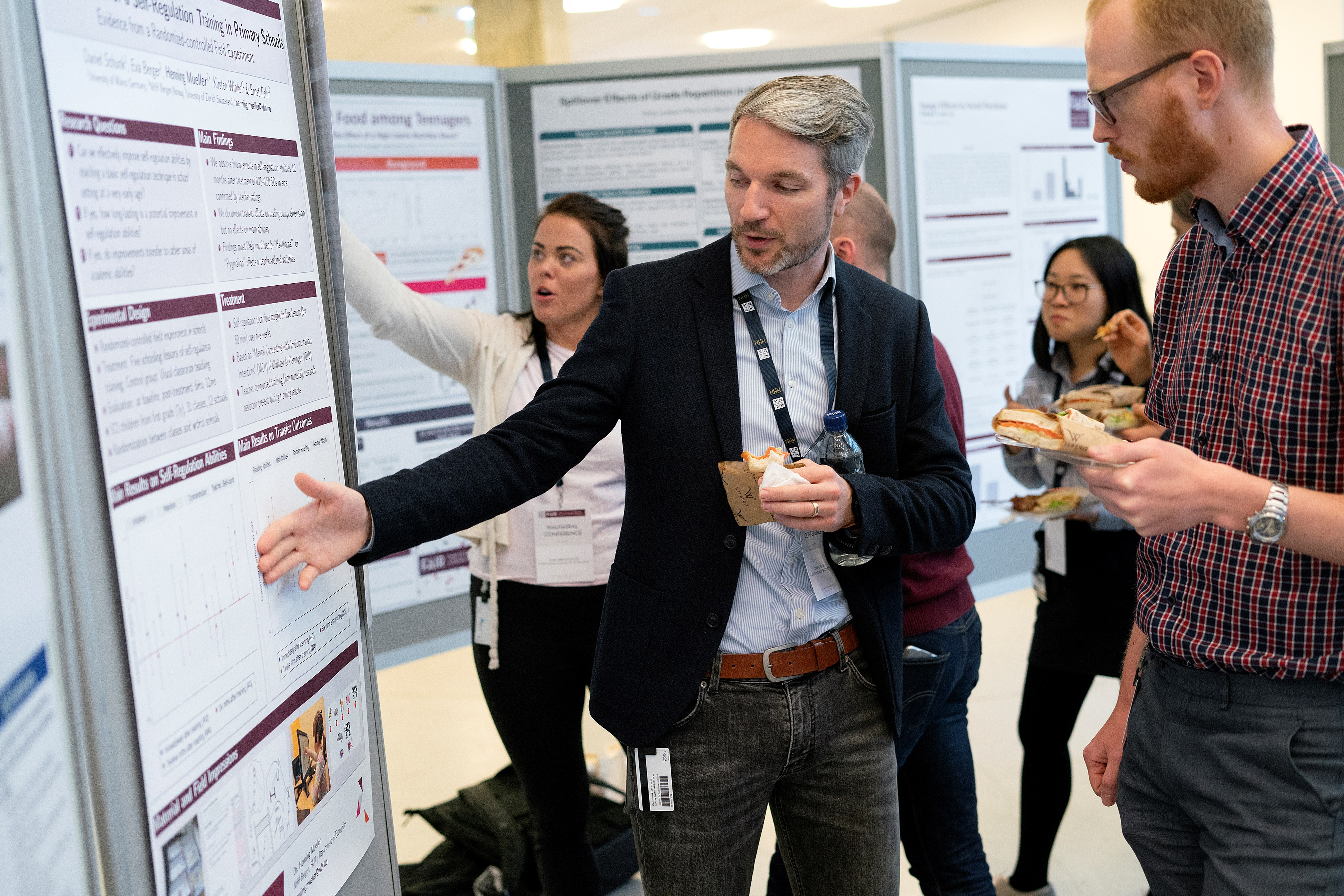 Henning Müller and Sigbjørn Råsberg at the poster session at FAIR Inaugural Conference.
